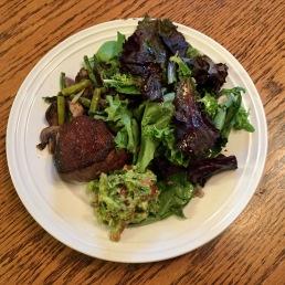 steak, salad, sautéed mushrooms, asparagus, onion, and guacamole
