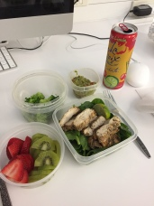 Spinach and chicken dressed with a squeeze of lime, broccoli, guacamole, sliced strawberries and kiwi, sparkling water