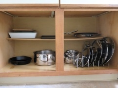 Pots and pans, plus some bakeware. I love this lid organizer (Ikea)